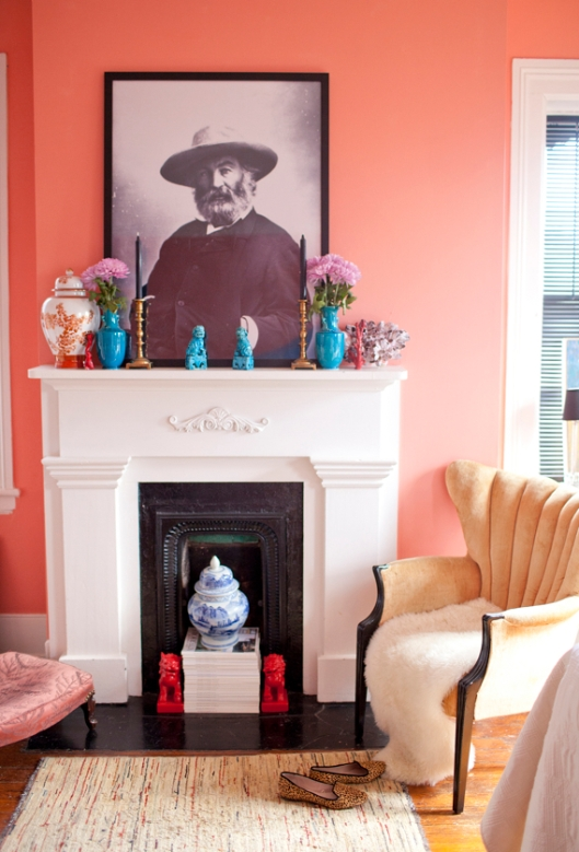 white fireplace pink walls