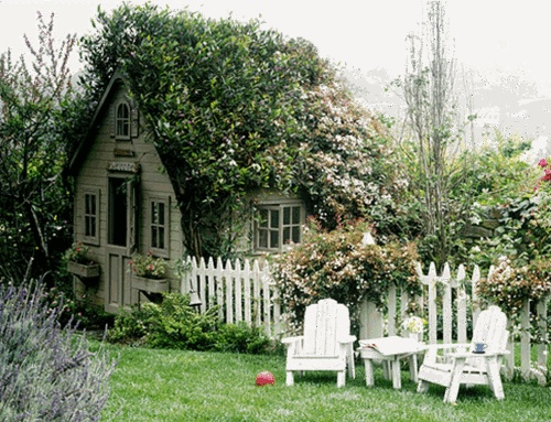 cottage covered in plants and flowers