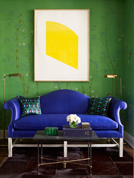blue couch green wall yellow painting