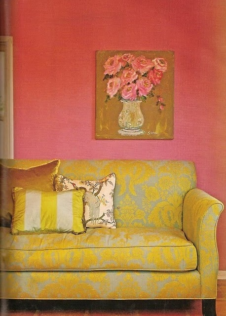yellow brocade couch with pink wall