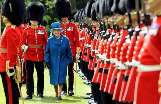 queen and british guards in uniform