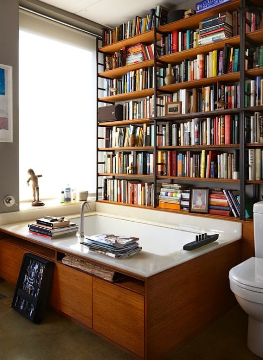 bath surrounded by books