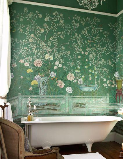 classic bath tub and antique wallpaper